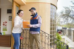 Courier Delivering a Package Stock Images