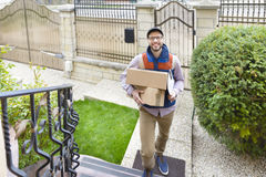 Courier Delivering a Package Stock Image