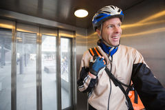 Courier Delivery Man With Backpack In An Elevator Royalty Free Stock Image