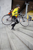 Courier Delivery Man With Bicycle And Backpack Stock Images