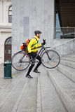 Courier Delivery Man With Bicycle And Backpack Royalty Free Stock Photos