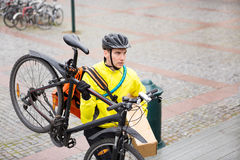 Courier Delivery Man With Package And Bicycle Royalty Free Stock Image