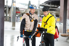 Courier Delivery Men With Bicycles Using Digital Royalty Free Stock Image