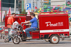 Courier delivery service bike, Beijing, China. BEIJING-JULY 24, 2015. Courier delivery service bike. Thanks to the country's e-commerce boom, China has Stock Image