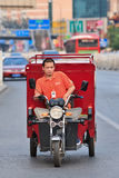 Courier delivery service bike on the road, Beijing, China. BEIJING-JULY 10, 2015. Courier delivery service bike. Thanks to the country's e-commerce boom, China Royalty Free Stock Photos