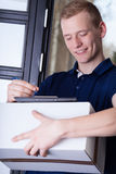 Courier fill out documents about delivery Stock Photo