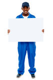 Courier guy presenting blank white billboard Stock Photos