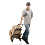 Courier hand truck boxes and packages Royalty Free Stock Image