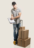 Courier hand truck boxes and packages Royalty Free Stock Images