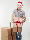 Courier, a handcart gift boxes Stock Photography