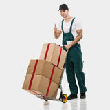 Courier, a handcart gift boxes Stock Photos