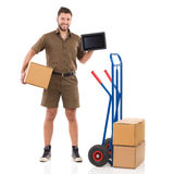 Courier holding a digital tablet Royalty Free Stock Image