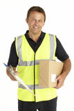Courier Holding A Parcel And Clipboard Royalty Free Stock Photo