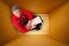 Courier inside empty box Royalty Free Stock Images
