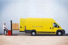 Package loading, the shipment has been processed in the parcel center. Courier is loading the van with parcels Royalty Free Stock Images