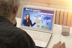 Courier and mail logistics. Man referring to the cast of parcel in line Royalty Free Stock Image