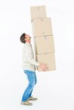 Courier man balancing cardboard boxes Stock Photography
