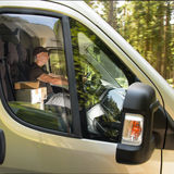 Courier man driving car delivering postal package Stock Images