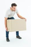 Courier man picking up cardboard box Royalty Free Stock Photos