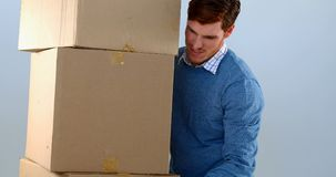 Courier man picking up cardboard boxes 4k stock footage