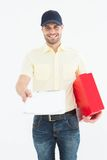 Courier man with red box giving clipboard Royalty Free Stock Photo
