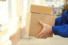 Courier with parcels outdoors. Closeup Royalty Free Stock Image