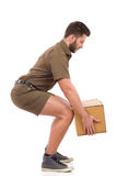 Courier picking up a package. Stock Photo