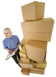 Courier and pile cardboard boxes Royalty Free Stock Photography