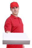 Courier in red uniform with box in hands Royalty Free Stock Photo