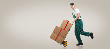 Courier runs - the trolley: packages and gifts Stock Images
