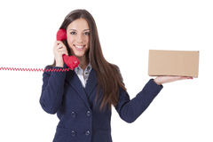 Courier service. Girl with phone and cardboard box Stock Photo