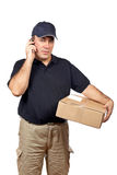Courier talk with cellphone. A courier delivering a package and talk with cellphone on white background Royalty Free Stock Image