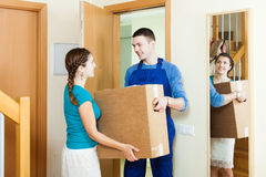 Courier in uniform brought package to housewife Royalty Free Stock Photography