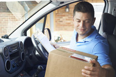 Courier In Van Delivering Package To Domestic House. Courier In Van Delivering Package To House stock photo