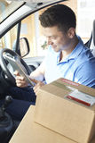 Courier In Van With Digital Tablet Delivering Package To Domesti Royalty Free Stock Photos