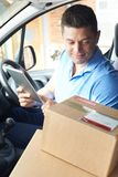 Courier In Van With Digital Tablet Delivering Package To Domesti Stock Images