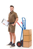 Courier waiting with a clipboard Stock Images
