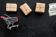 Courier workplace with cardboard box and trolley for delivery on black background top view mockup. Courier workplace with cardboard box and trolley for delivery Stock Images
