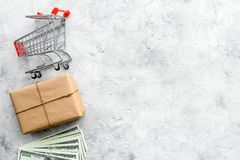 Courier workplace with cardboard box and trolley for delivery on stone background top view mockup. Courier workplace with cardboard box and trolley for delivery Stock Photography