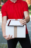 Courier writing a transport document Stock Photography