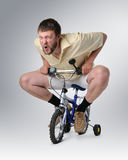 Courious man on a bicycle Royalty Free Stock Photo