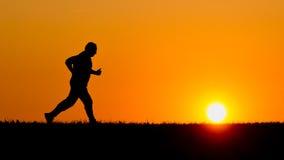 Courir dans le coucher du soleil Photographie stock