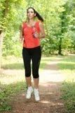 Courir de fille de forme physique Image stock
