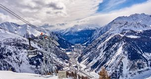 COURMAYEUR, ITALY - MARCH 7, 2018: The cable railway to Monte Bi royalty free stock images
