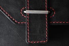 Couro preto costurado com linha vermelha fotos de stock royalty free