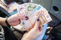 Couronne d'argent, yuan, rouble, euro Photographie stock