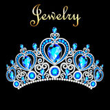 couronne femelle, diadème, avec les pierres précieuses bleues Image stock