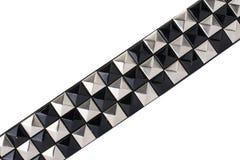 Courroie en cuir noire avec des goujons de chrome photo stock