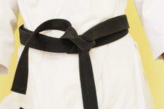 Courroie noire de karaté Image stock