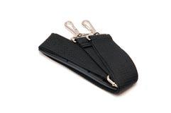 Courroie noire pour un sac sur un fond blanc Photos libres de droits